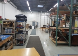 A professional craftsman working in the facility of Furniture Medic in Carol Stream, IL