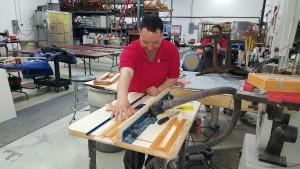 Furniture Medic team refinishing wooden desk in Carol Stream IL